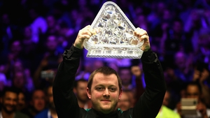Mark Allen lifts the Masters trophy