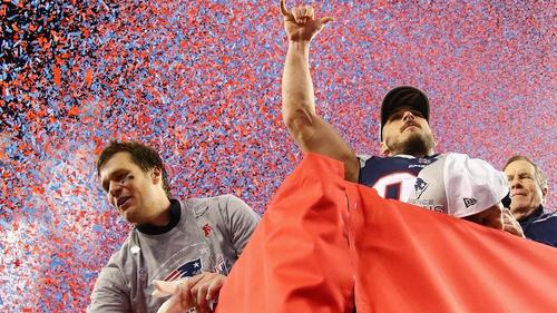Tom Brady (l) celebrates another AFC title