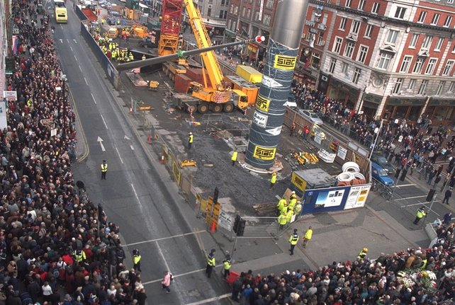 Crowds on O'Connell Street gather to watch the raising of the final section of the Spire of Dublin (or 'Spike'), at about 12.30pm on 21 January 2003.