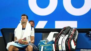 Novak Djokovic of Serbia struggles between games due to his injured elbow