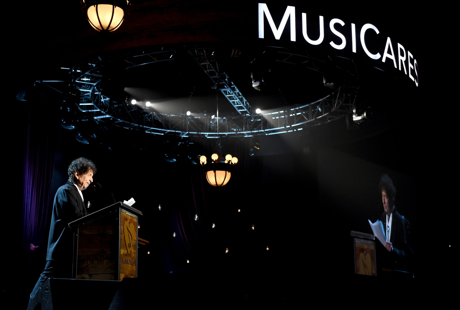 Image - Bob Dylan speaks onstage at the MusiCares 2015 Person Of The Year Gala.