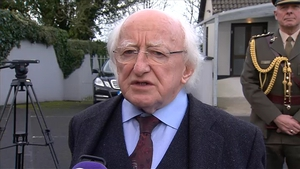 President Higgins attends the removal in Ballyneety
