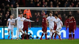 Alfie Mawson celebrates after scoring the only goal against Liverpool at the Liberty Stadium on Monday night