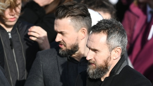 The Cranberries band members, Mike Hogan (C) and Noel Hogan (R) were among the mourners