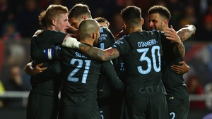 Manchester City players celebrate their second goal against Bristol City