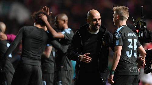 Pep Guardiola congratulates his players following the Carabao Cup semi-final victory over Bristol City