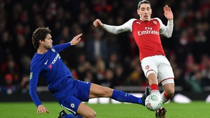 Chelsea's Marcos Alonso (L) tackles Hector Bellerin