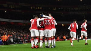 Arsenal players celebrate their first goal