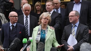 Julie Hambleton (centre) and the relatives of those killed want to find out who planted the bombs