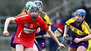Cork's Orla Cotter (L) holds off Wexford's Aoife Guiney