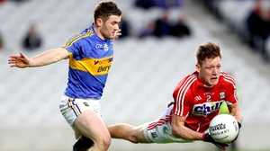 Tipperary's Liam McGrath (L) and Sam Ryan of Cork