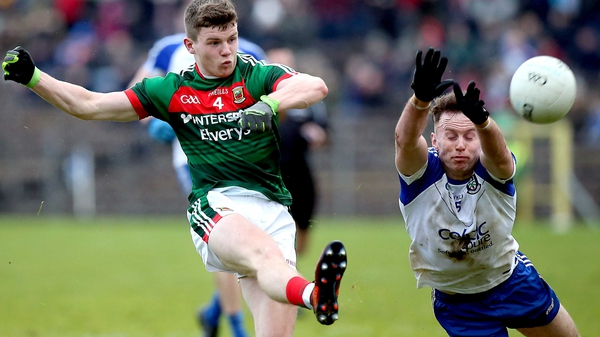 Monaghan's Fintan Kelly with Mayo's Eoin O'Donoghue