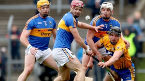 Tipperary's Padraic Maher, Alan Flynn and Ronan Maher with John Conlon of Clare