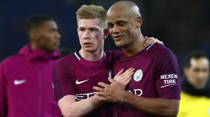 Kevin De Bruyne (L) and Vincent Kompany celebrate City's win