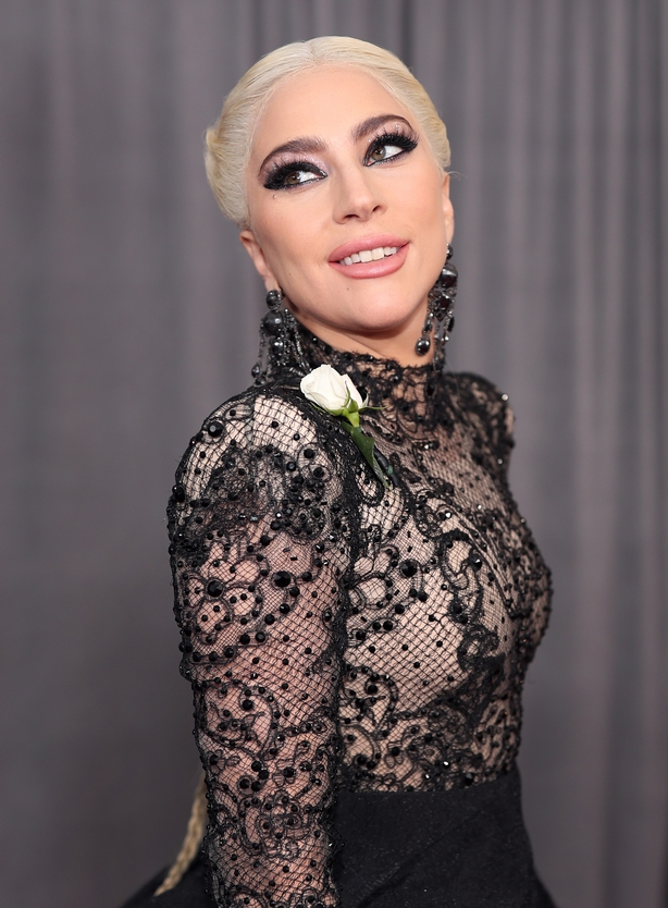 Lady Gaga wore a white rose on the red carpet in support victims of sexual harrassment