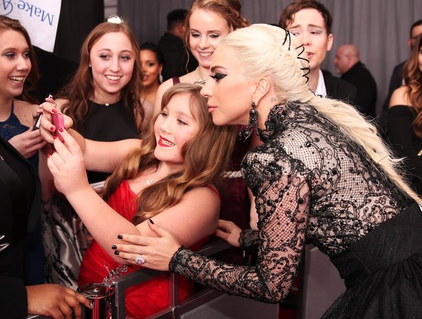 Gaga strikes a pose with a young fan