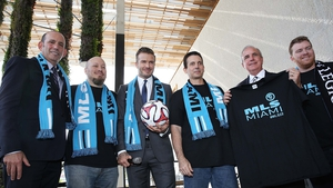 David Beckham (C) at a press conference to announce plans to launch an MLS franchise in Miami