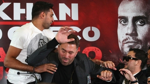Amir Khan threw water as his opponent during their press conference