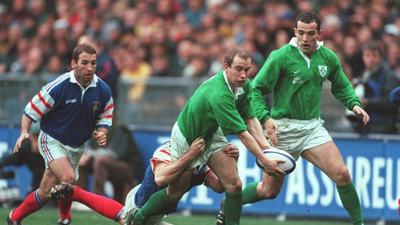 Image - Scrum half Conor McGuinness and full-back Conor O'Shea in action in Paris in 1998.