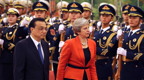UK's Theresa May heads for China as rivals plot her demise