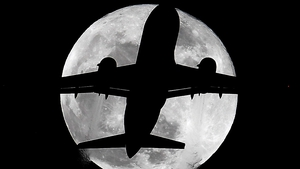 A plane passes in front of the moon in London. The supermoon was visible across the world.