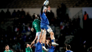 Thomas Lavault wins a line-out despite the close attentions of Ireland's Jack Dunne
