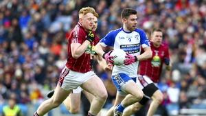 Knocknagree's Padraig Collins runs past Multyfarnham's Daniel Loughrey