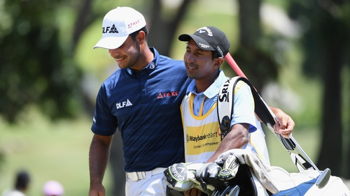 Shubhankar Sharma celebrates with his caddy