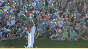 Fowler watching his birdie putt on the 18th on Saturday