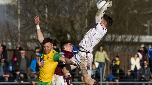 Galway goalkeeper Ruairí Lavelle fields a high one over Donegal's Eamonn Doherty