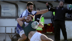 Kildare's Fergal Conway is fouled by Neil McAdam of Monaghan
