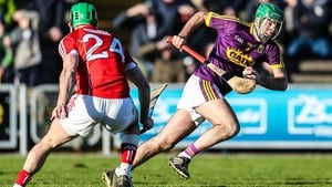 Wexford defender Shaun Murphy breaks free of the challenge of Cork's Michael Cahalane