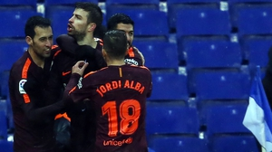 Gerard Pique is mobbed after his goal