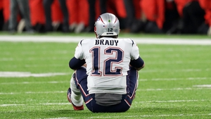 Tom Brady sits dejected following defeat to the Eagles