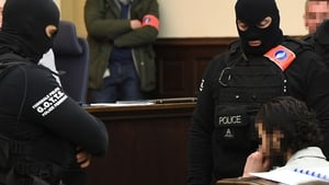 Salah Abdeslam sits as he is surrounded by Belgian special police officers in the courtroom  in Brussels