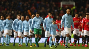 Manchester City and Manchester United enter the field for their clash at Old Trafford last December