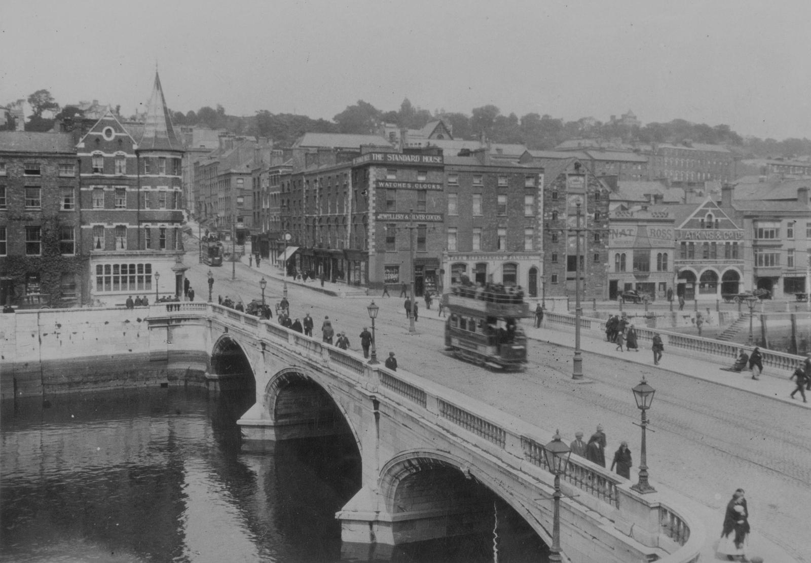 Image - A tram crosses the bridge in Cork City, Ireland, circa 1930.