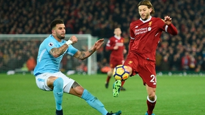 Adam Lallana (R) came on as a sub against Manchester City