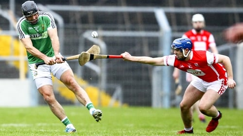 David Collins of Liam Mellows is tackled by Cuala's Sean Treacy