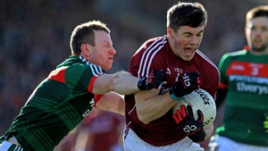 Mayo's Colm Boyle tackles Shane Walsh of Galway