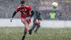 Niall Sludden kicks a free in the snow