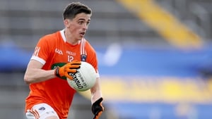 Rory Grugan scored three points as Armagh returned to Division 1 with victory in Ennis