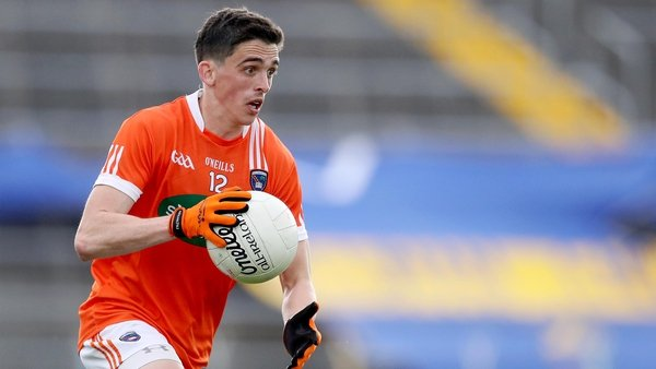 Rory Grugan nailed a point in the fifth minute of injury-time to give Armagh a dramatic victory in the top of the table clash against Longford