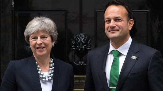 May says there is 'basis for an agreement' at Stormont