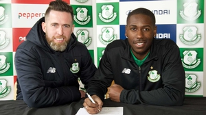 Daniel Carr (R) signs on the dotted line