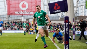 Jacob Stockdale runs in one of eight Irish tries against Italy