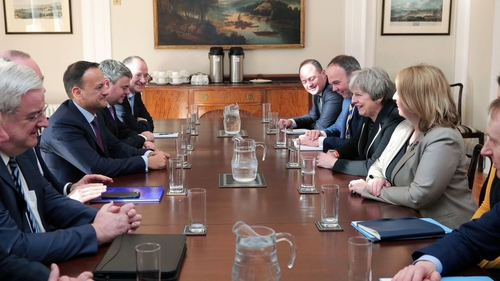 A photograph of the Irish and British government teams meeting in Stormont