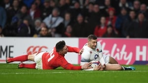 England's Jonny May slides in for a try in their 12-6 victory over Wales at Twickenham