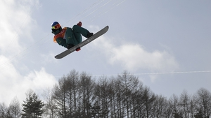 A snowboarding competitor in action at the Winter Games