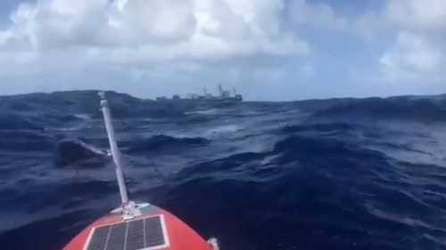 Damian Browne posted footage of his encounter with a cargo ship on social media